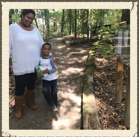 Mother and son enjoy the Horizons Unlimited StoryWalk on the nature trail.