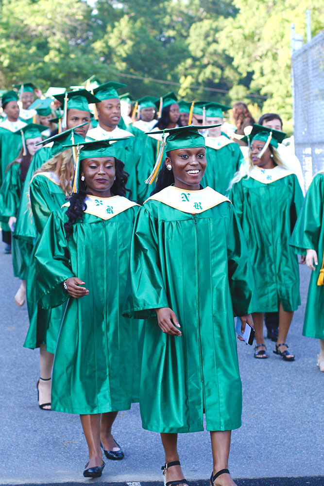 students walking to graduation ceremony 2017